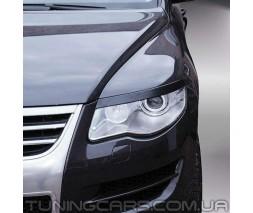 Накладки на фары (реснички) Volkswagen Touareg (06-09)